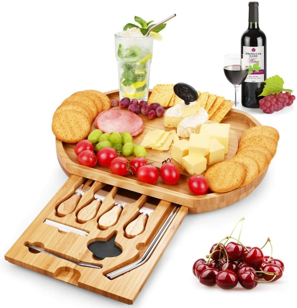 charcuterie board with cheese, deli meats, and wine