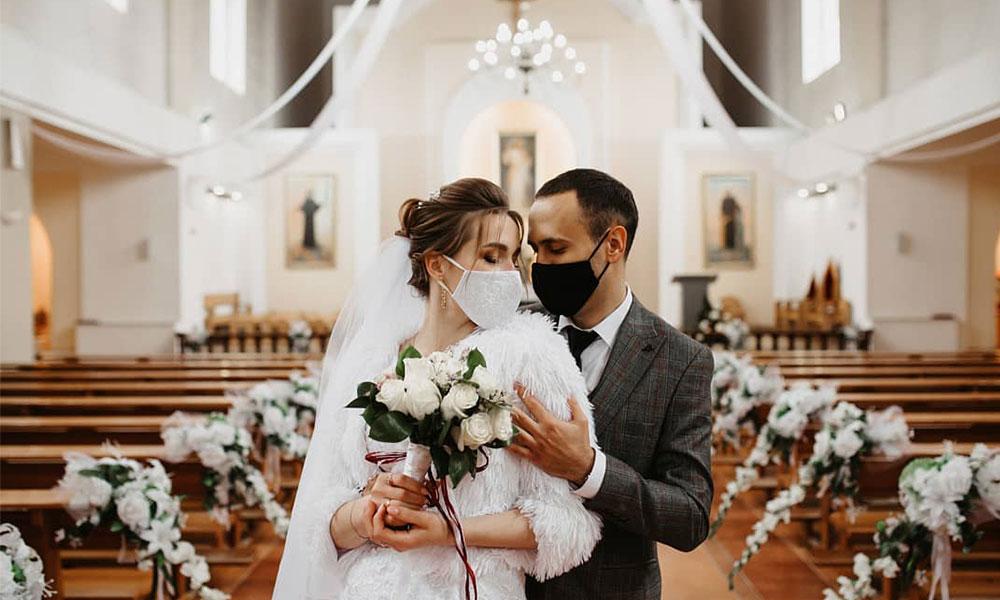 COVID bride & groom inside empty church
