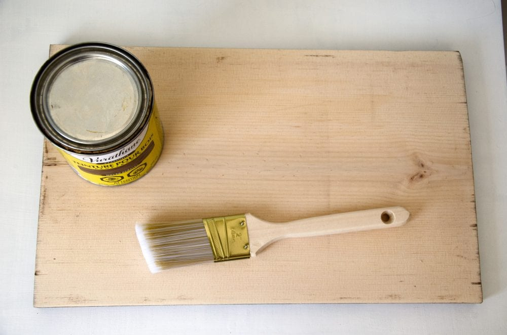 Guestbook supplies with wood stain, paint brush, wood slab