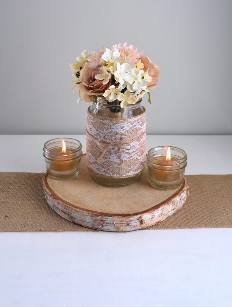 Burlap and lace wrapped mason jar with flowers