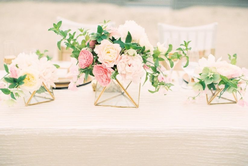 gold geometric vases on table