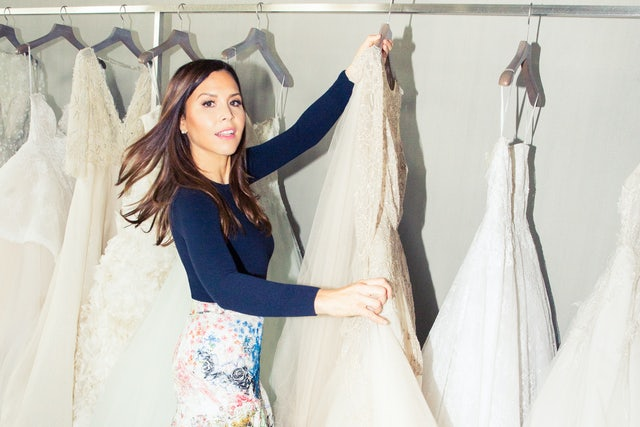 Monique Lhuillier with wedding dresses on the rack