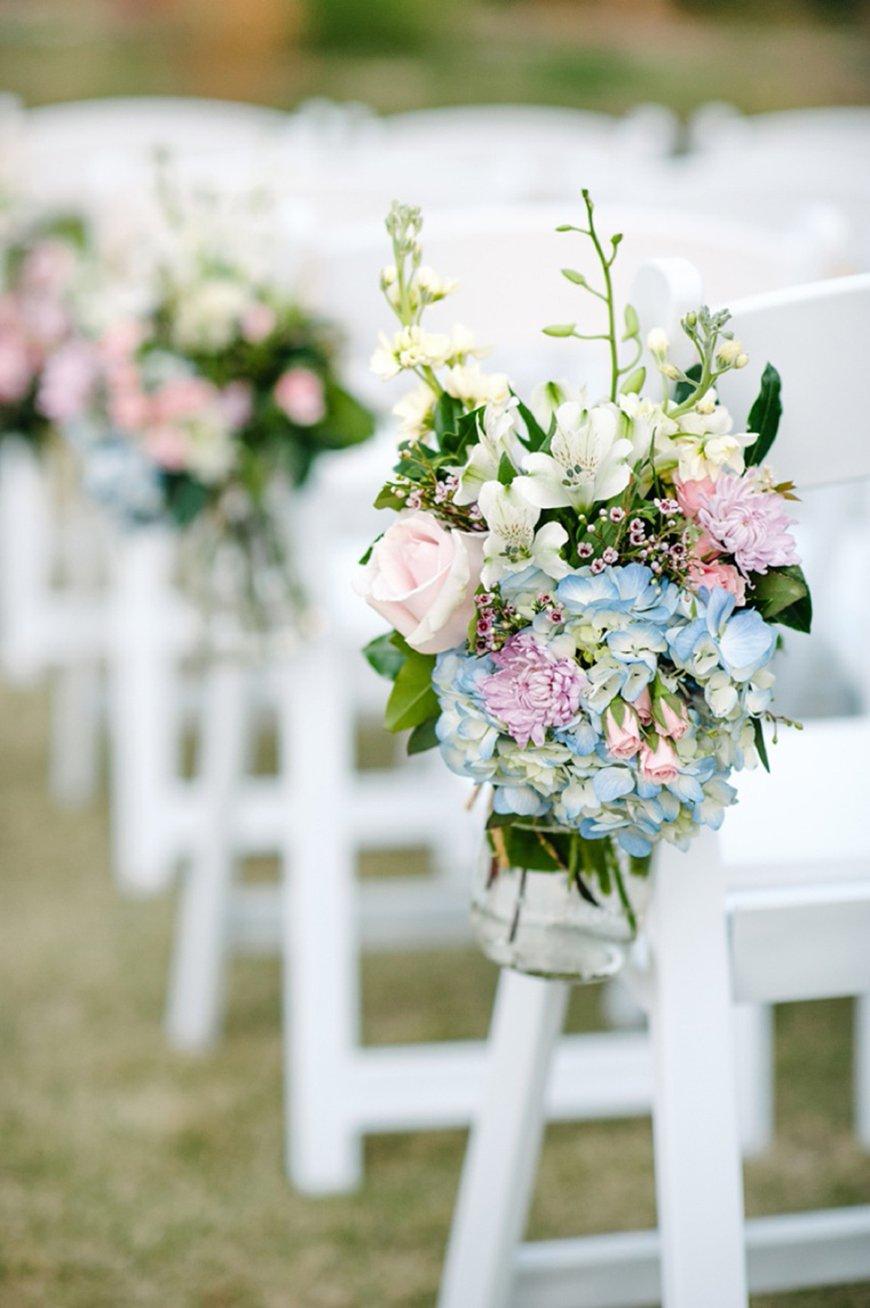 Pastel pink aisle florals