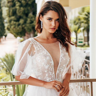 Beautiful bride wearing flutter sleeves
