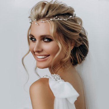 Bride accessorizes with simple hair vine