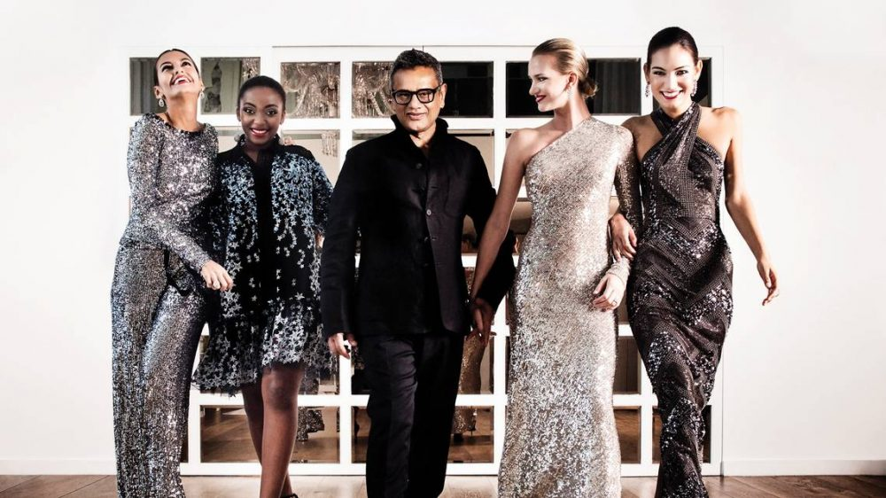 Naeem Khan with a group of models