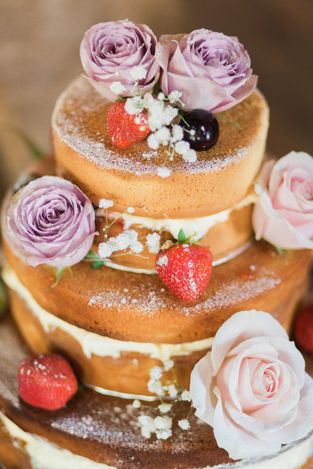 Naked wedding cake with lavender flower decorations