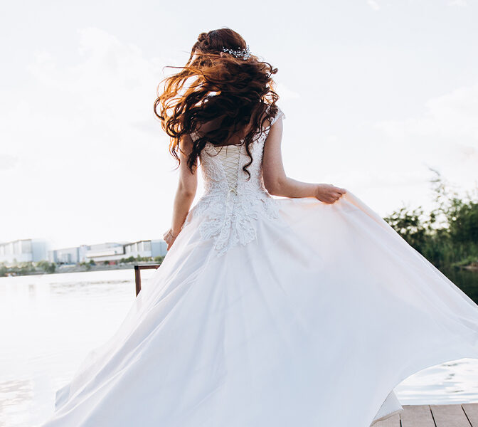 Woman Twirling in Beautiful Wedding Dress