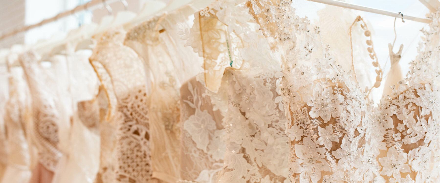 Nudes and Neutrals wedding dresses on a rack
