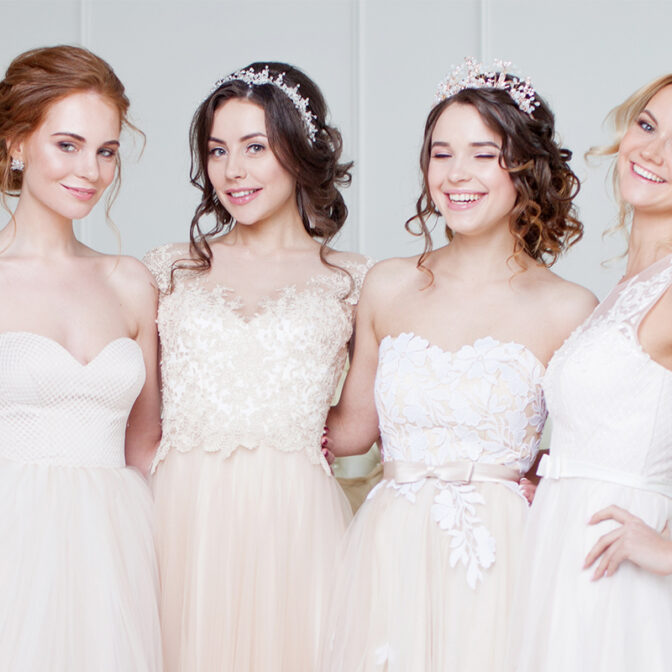 Brides wearing different shades of white wedding dresses