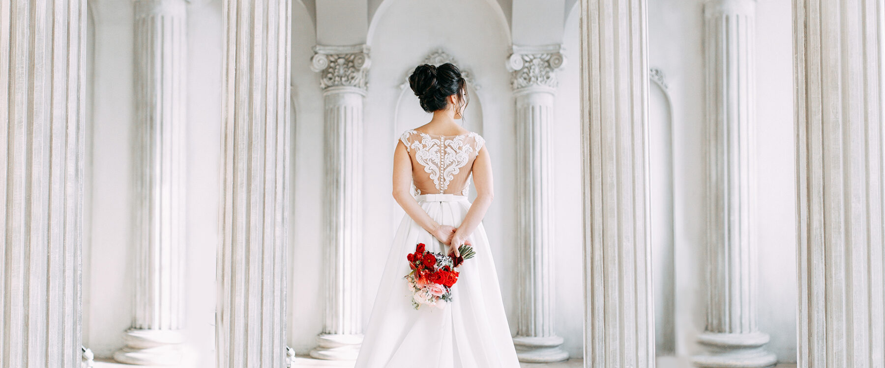 Bride showing off the stunning back of her dress
