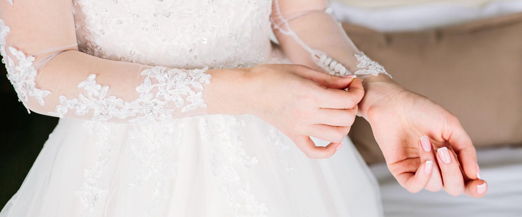 Bride Tugging on wedding dress sleeve