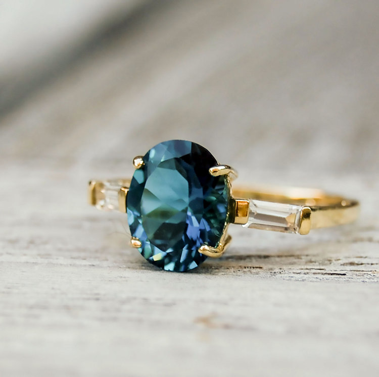 Oval blue gemstone ring