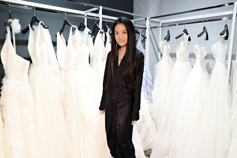 Photo of Vera Wang with her wedding gowns