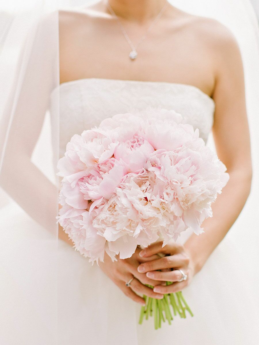 Bride holding pink peony bouquet