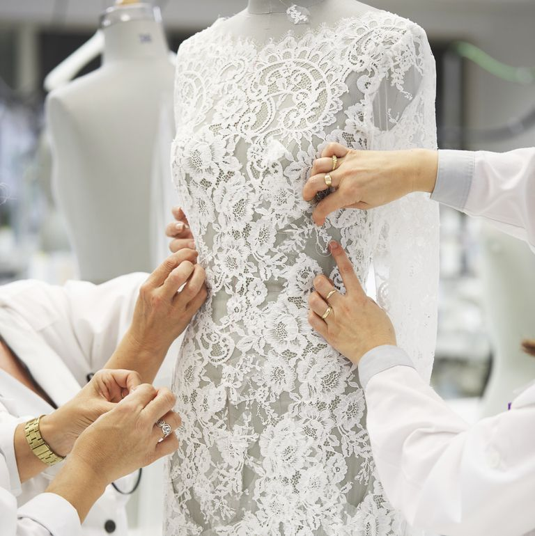 Seamstresses working on a Pronovias gown