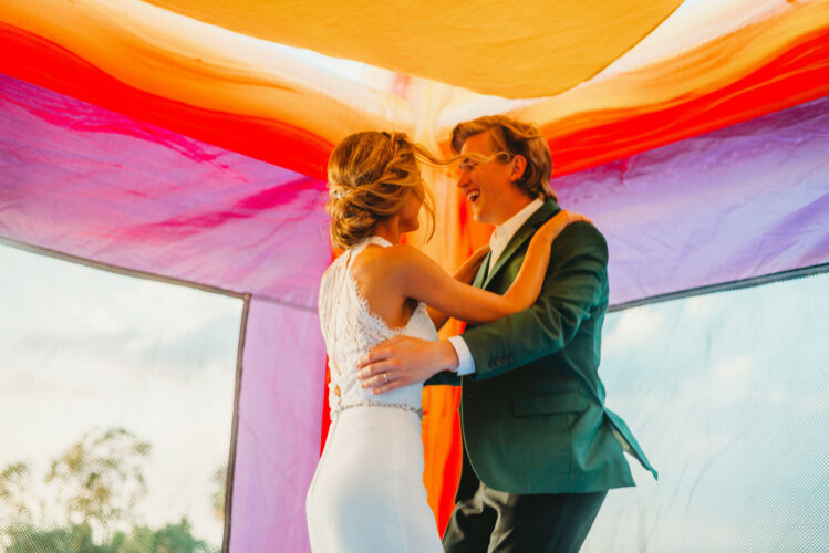solve your wedding planning dilemmas by doing what makes you happy, like getting a wedding bounce house!