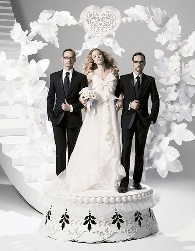 Viktor&Rolf standing with a model bride
