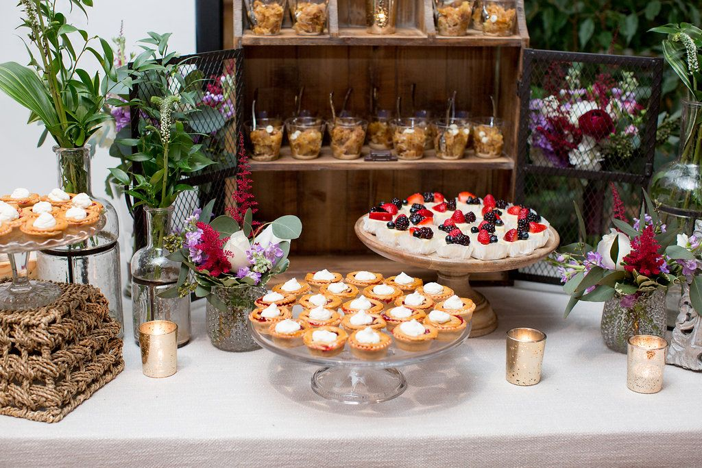 dessert table with greenery