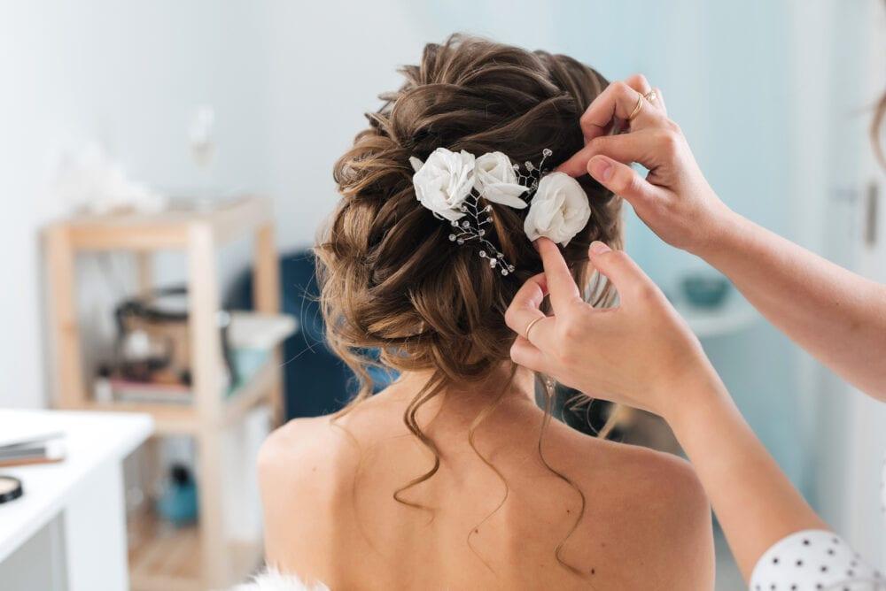 Bride having her hair fixed