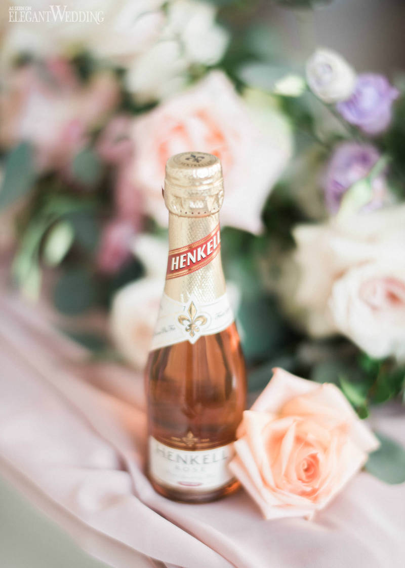Wine & coral roses on table
