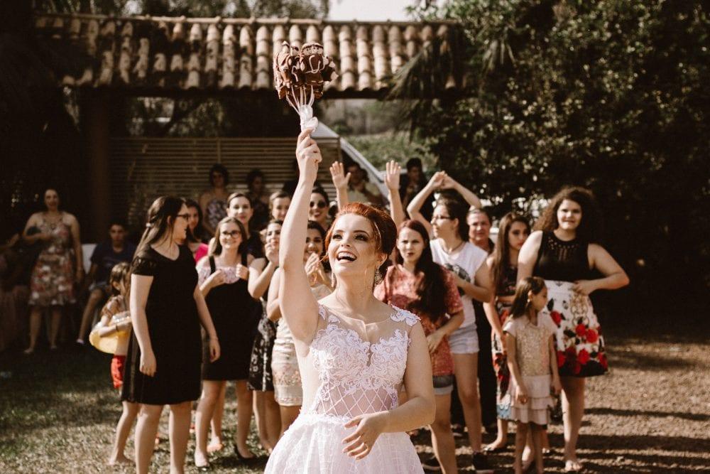 bride throwing bouquet to women
