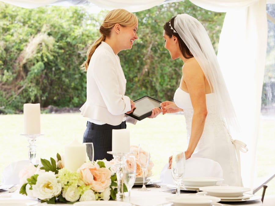 Bride talking with her wedding planner