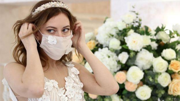 Bride wearing a mask
