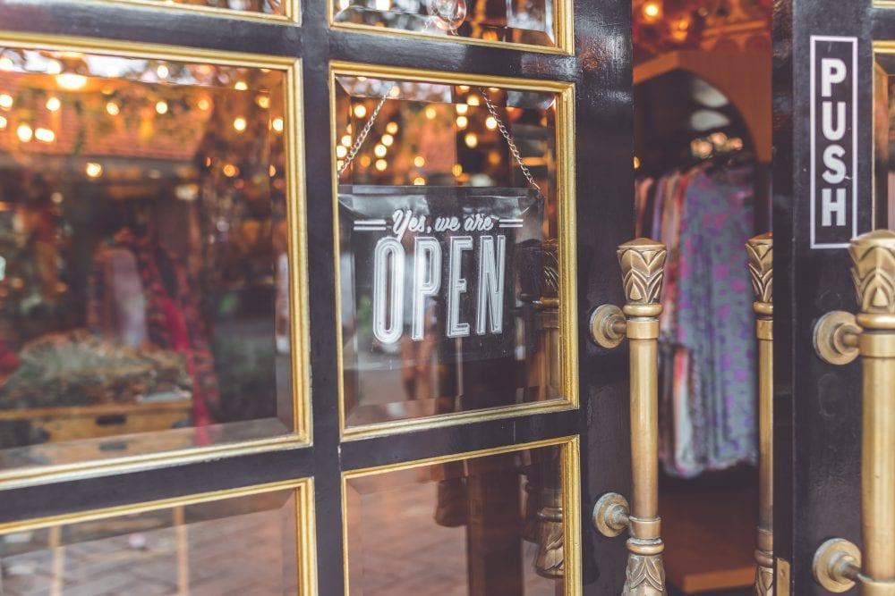 partially open door entering into clothing shop