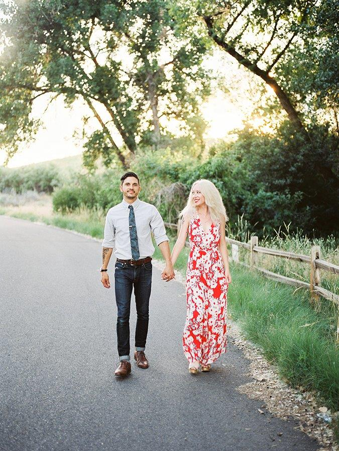 walking hand in hand engagement photo idea