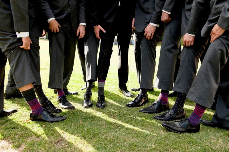groomsmen showing off fun socks