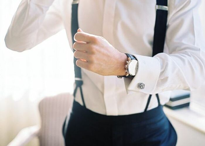 groom with watch, cufflinks, bow tie