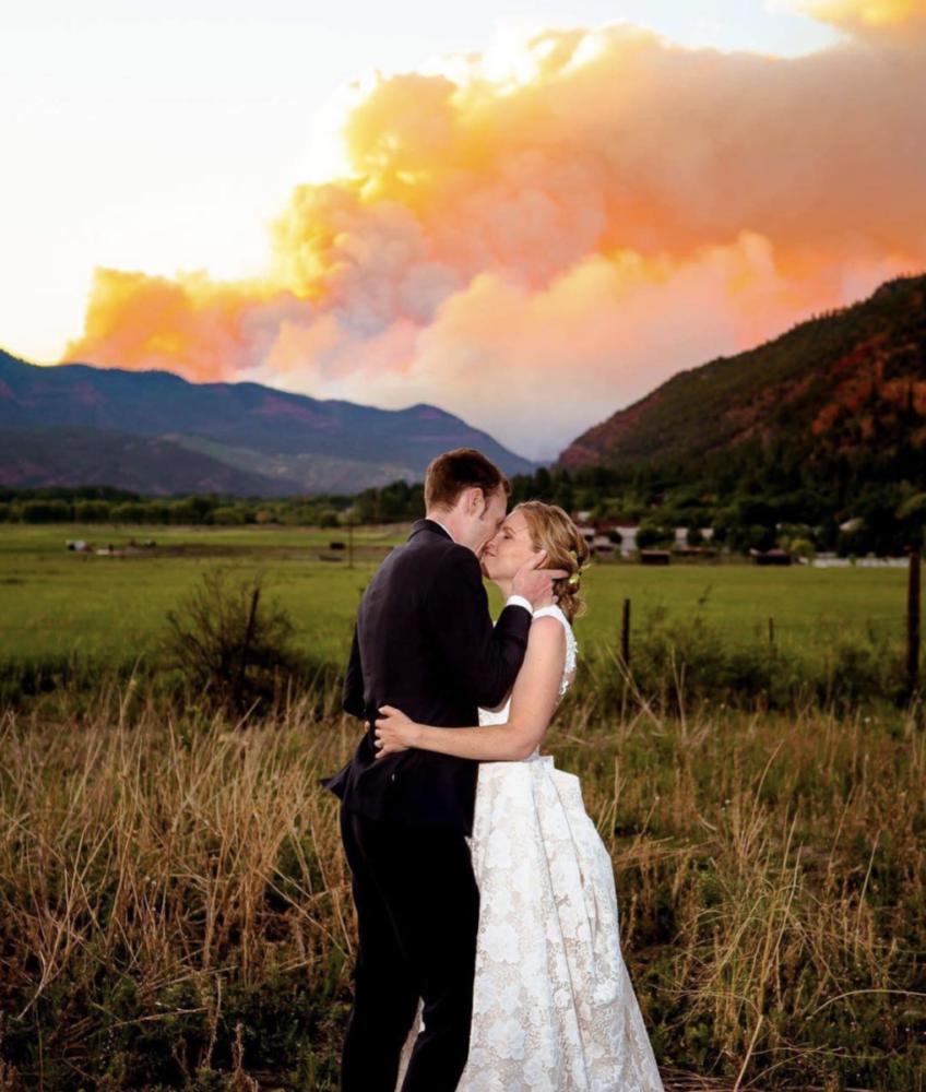 Fiery wedding photo of Sara McLaughlin & Michael Kramer