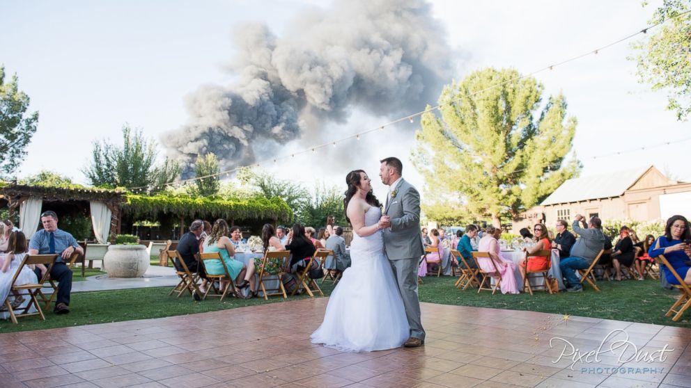 Smokey wedding photo of J.T. & Carly Morrissey