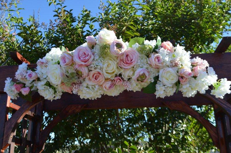 Rose-Filled Wedding Arch