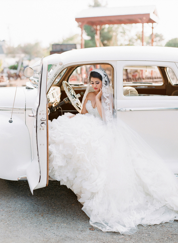 Pose With Your Dress Flowing Out Of A Classic Car