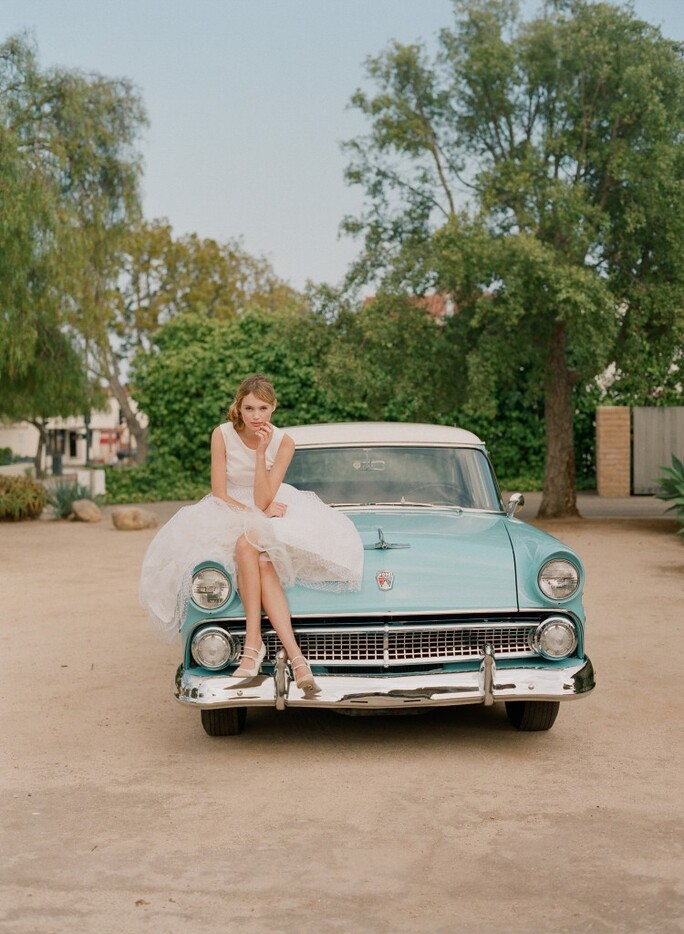 Pose Sitting On Top Of A Classic Car