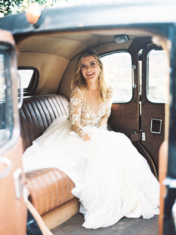 Pose Sitting Inside A Classic Car