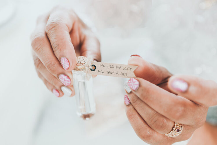 wedding manicure holding romantic note on wedding day