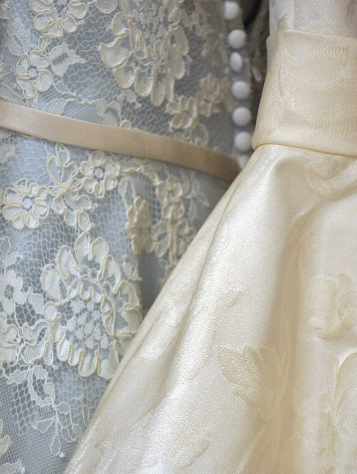 clothing rack with blue and cream colored wedding dresses