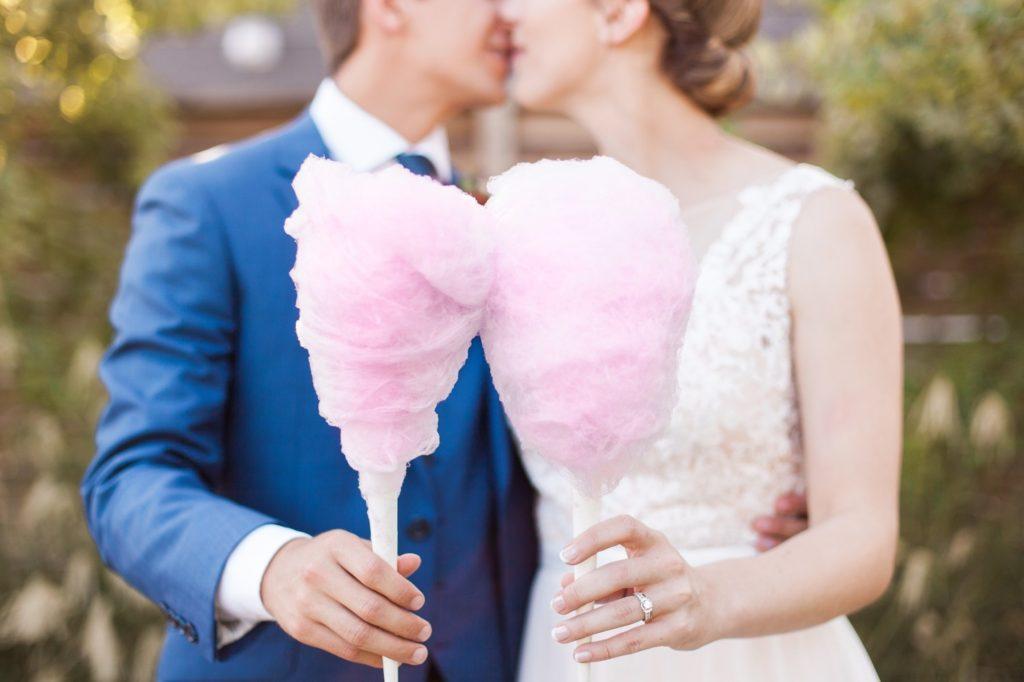 Cotton candy wedding snacks create a carnival wedding menu.