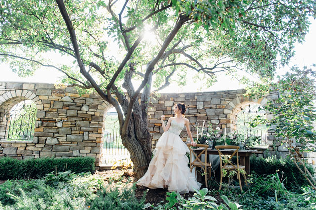 A stunning and poetic botanical rhapsody bridal inspiration shoot featuring untamed greenery, a tranquil garden setting and a fairy tale gown by Ali and Batoul Photography