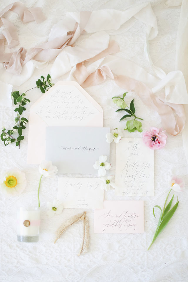 A stunning sunset bridal inspiration shoot with a welcome basket, ethereal calligraphy and exquisite florals by Anny. Photography