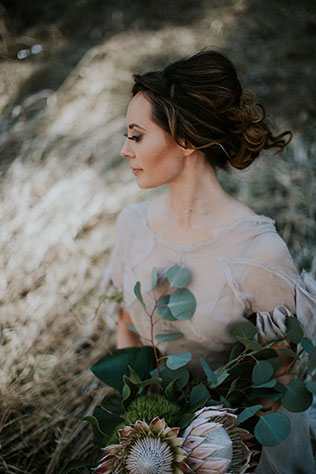 An ethereal and romantic bridal inspiration shoot with fluttering gowns and magical winter light by Blue Rose Studio