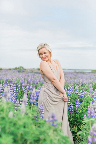 Lovely bohemian bridal portraits amongst the gorgeous purple lupine flowers in Iceland by Danielle Giroux