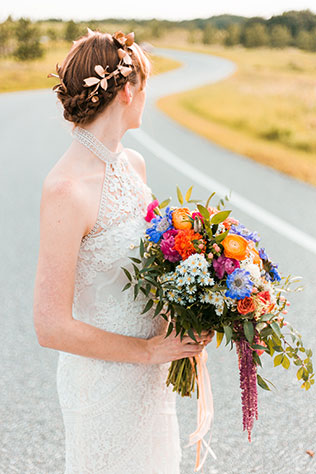 Bohemian bridal portraits with a lovely polished look and an incredibly lush bouquet by Justin Gilbert Photography