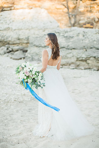A quietly romantic beach bridal session with muted and deep blues by Kortney Boyett Photography