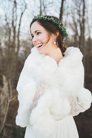 Elegant winter eucalyptus bridal portraits in Chicago by Megs Colleen with a handmade wedding gown from Cambodia