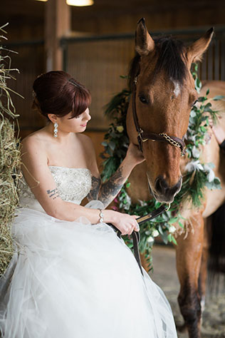Gorgeous snowy white bridal portraits with a horse by Stella Blue Photography