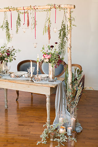 An exquisite dusty blue, burgundy and blush winter wedding styled shoot with lush florals and a romantic sweetheart table by Alexandra Lee Photography